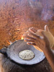 Native woman pats corn tortillas into shape before cooking in native Mayo village of Capomos, Mexico