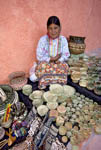 Tarahumara native Indian woman sits with woven baskets that she makes and sells to tourists in the Divisadero area of Copper Canyon in Mexico.