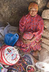 Elderly Tarahumara native woman sits with her crafts that are for sale to tourists in Sebastian Cave outside the town of Creel in Copper Canyon.