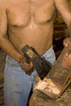 Man chisels wood to make a saddle in La Noria, a small town 33 km (21 miles) northeast of Mazatlan, Mexico.