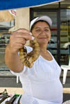 Woman offers giant shrimp for sale on a side street in the Centro District of Mazatlan, Mexico. This is a popular place for local people to buy fish.