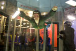 "Woman tries flyng in ""I Fly Utah,"" a vertical wind tunnel that gives people a free fall experience."