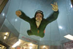 """Woman tries flying in """"I Fly Utah,"""" a vertical wind tunnel that gives people a free fall experience."""