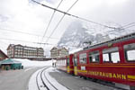 Train station at Kleine Scheidegg which connects to a cog railroad that crosses the Eiger mountain on its way to Jungfraujoch at 3454 meters (11,333 feet), the highest train station in Europe. Here people can visit an ice palace, view a glacier and visit a weather station. Here you see the cog train sitting on the track waiting to leave for Jungfraujoch.