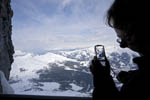 Visitors photograph the mountains from viewpoint along the train route from Kleine Scheidegg to Jungfraujoch above Grindelwald, Switzerland.