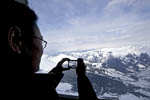 Visitors photograph the mountains from viewpoint along the train route from Kleine Scheidegg to Jungfraujoch, high above Grindelwald, Switzerland