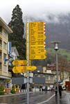 Road sign with distances to various cities seen on a street in Weggis, a small town on Lake Lucerne near the Swiss City of Lucerne.