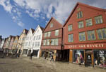 Waterfront in Bergen, Norway known as the Bryggen district. Old wood buildings date back to the 1700s and today hold craft, tourist and clothing shops.