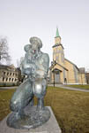 Bronze sculpture in front of The Cathedral in Tromsø, Norway. This is one of the largest Protestant wooden churches in Europe.