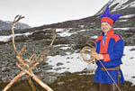 Middle aged Sámi man demonstrates techniques for lassoing reindeer at his camp near the Norwegian town of Kjøllefjord.