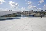 """""""The Carpet,"""" a sloping stone ramp of white Italian marble leading to the roof of The Oslo Opera House."""