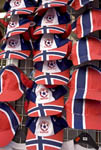 Hats with Norwegian flag design for sale on city street in Oslo, Norway.