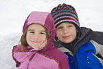 Children play in snow during winter, USA.