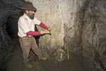 Gold Bug Mine, an old gold mine dating back to the mid 1800s when the first gold rush in North America began. Here, a guide posing as a miner demonstrates how the men loaded the dynamite explosives.