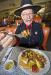 """Man dressed as 1800s town marshal eats a """"hangtown fry,"""" a hearty meal that dates back to the gold rush of the middle 1800s in California."""