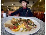"Man dressed as 1800s town marshal eats a ""hangtown fry,"" a hearty meal that dates back to the gold rush of the middle 1800s in California."