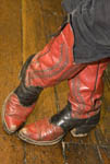 Authentic, well worn cowboy boots worn by a local man who dresses up as a sheriff for tourists in Placerville, an old gold mining town, California, USA.