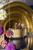 Burj al Arab hotel reception desk with women and balls of roses,Dubai, UAE. This is the hotel shaped like a sail.