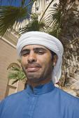 Arab man in typical clothing and headdress. Dubai, UAE.
