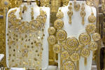 Gold necklaces in store window in Dubai's Gold Souk or old market.