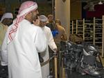 Arab men at Ski Dubai, an indoor ski resort in the Mall of the Emirates, Dubai.