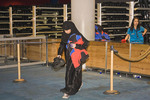 Muslim woman carries ski clothing at Ski Dubai, an indoor ski resort in the Mall of the Emirates, Dubai.