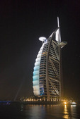 Burj Al Arab hotel at night. Sail shaped luxury hotel in Dubai, UAE.