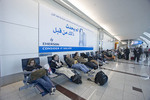 Dubai International Airport with travellers at rest.