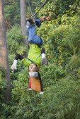 """""""Flying"""" upside down on zipline at canopy tour"""