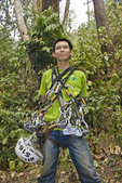 Man with zipline gear at canopy tour