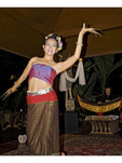 Thai women performing traditional dances in Thailand.