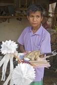 Lisu tribal man holds sacrifice to ghosts in Lisu Village
