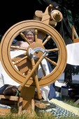 Woman demonstrates how to spin wool at Living History fair on the grounds of Old Mission State Park in Cataldo, Idaho.