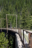 Cyclists ride across a bridge along the Hiawatha Trail, a bicycling and hiking trail in Idaho, USA.