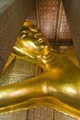 Giant reclining Buddha statue in Wat Pho, Bangkok, Thailand.