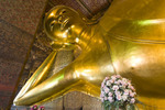 Giant reclining Buddha statue in Wat Pho, Bangkok, Thailand. It is Bangkok's oldest and largest temple.
