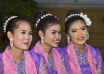 Young Thai women in traditional costume at Thailand Tourism Authority Golden Jubilee Grand Reception, Bangkok, Thailand.
