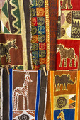 Colorful African patterns on cloth for sale at craft village in Zambia, Africa