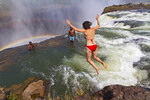 Woman jumps into Devil's Pool at Victoria Falls.