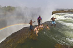 Visitors swim in Devil's Pool at Victoria Falls.