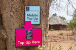 Sign for mobile (cell) phone charging station in native village of Simoonga near  Livingston, Zambia, Africa