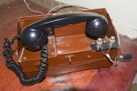 Old fashioned telephone with crank used to call from room to reception at Tongabezi Lodge in Livingstone, Zambia, Africa.