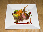 Entree, rack of lamb, served with house made lamb sausage, quinoa and a cauliflour puree at Talisker On Main, fine dining restaurant in downtown Park City, Utah, USA.