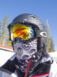 Skier dressed for the cold with reflective goggle and kerchief across his face, Mammoth Mountain ski resort, California, USA.
