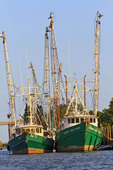 Fishing boats at dock along Apalachicola River, Apalachola, Florida, USA