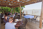 Boss Oyster, rustic restaurant with open air tables on a deck overlooking the Apalachicola River, Apalachicola, Florida