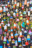 Painted fishing floats strung along a net in Apalachicola, Florida