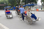 Tourists take cyclo tour in the historical district of Hanoi, Vietnam.
