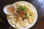 Mango salad, a popular Vietnamese dish, with mango, shrimp, squid and deep fried carmelized onions