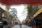 View of the historic old city district of Hanoi, Vietnam, seen from the seat of a cyclo, bicycle driven rickshaw.